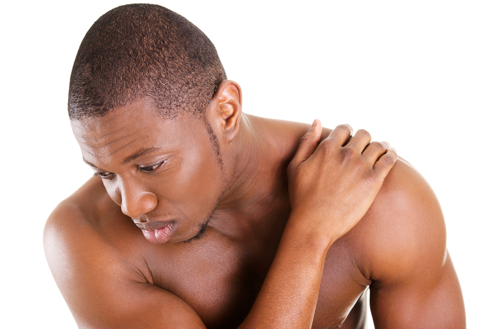 man suffering from chronic shoulder pain